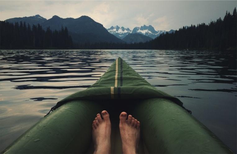 Man feet on kayack