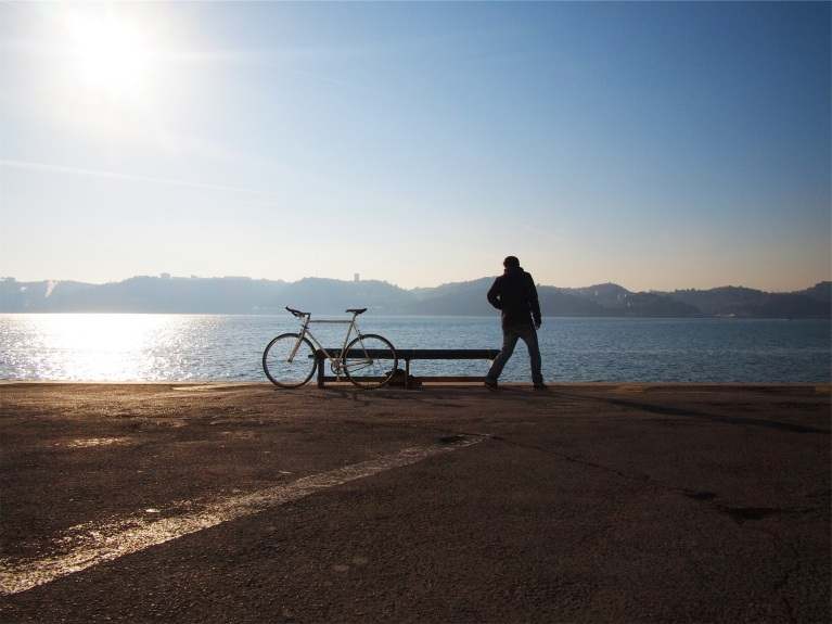 Man with bike at the beach