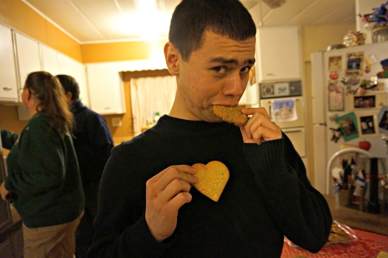 Brother eating heart cookie
